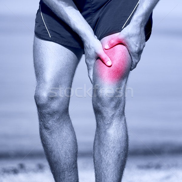 Muscle sports injury of male runner thigh Stock photo © Maridav