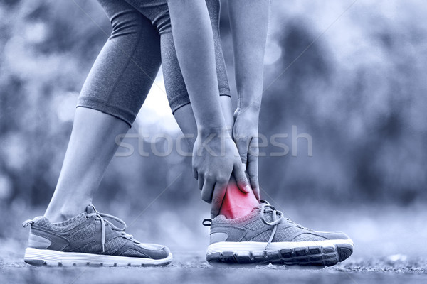 Stock photo: Broken twisted ankle - running sport injury