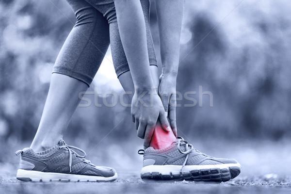 Broken twisted ankle - running sport injury Stock photo © Maridav