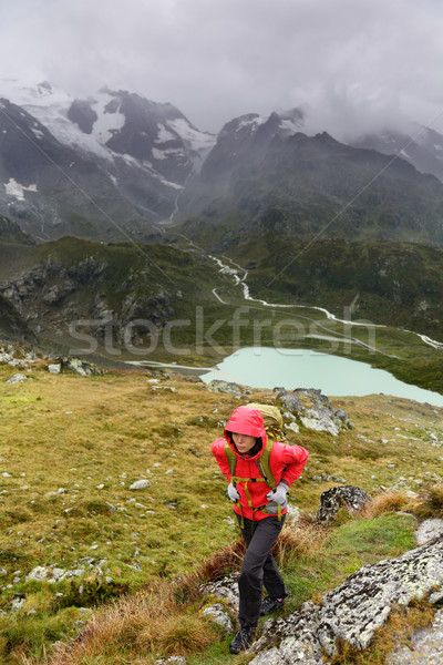 Hiker hiking on trek with backpack in rain Stock photo © Maridav