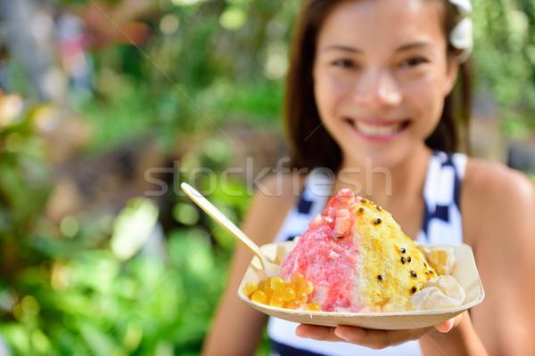 Hawaii woman eating Hawaiian shave ice Stock photo © Maridav