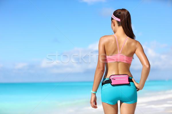 Runner woman with phone holder fitness smart watch Stock photo © Maridav