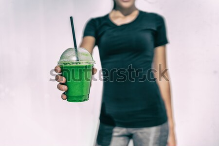 Green smoothie waitress woman serving cup at cafe Stock photo © Maridav
