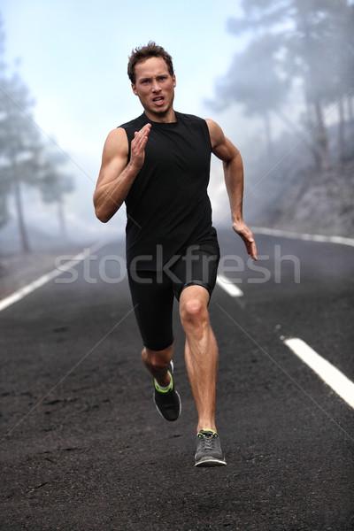 Running runner man sprinting workout on road Stock photo © Maridav