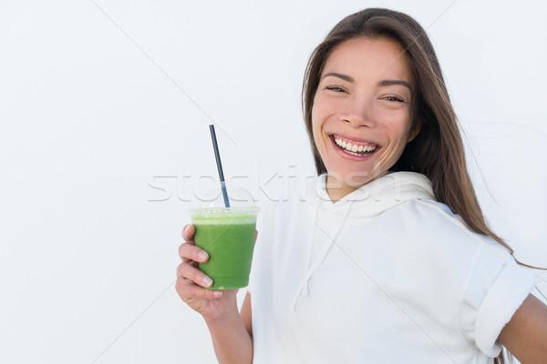 Happy Asian woman drinking healthy green smoothie Stock photo © Maridav