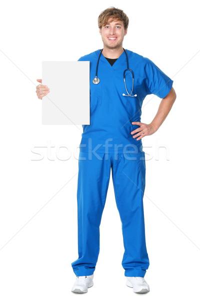 Stock photo: Doctor / nurse showing billboard sign
