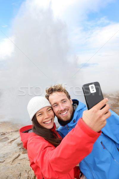 IJsland toeristen foto geiser paar gelukkig Stockfoto © Maridav
