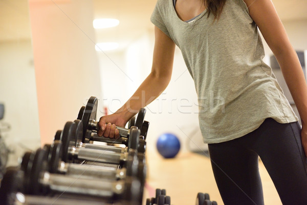 Gym woman strength training lifting weights Stock photo © Maridav