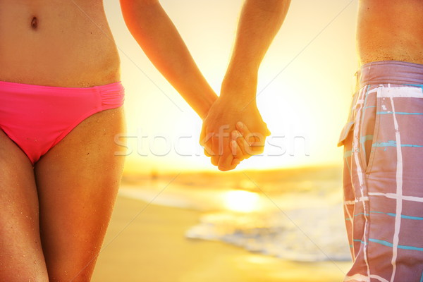 Beach sunset couple in love holding hands romantic Stock photo © Maridav