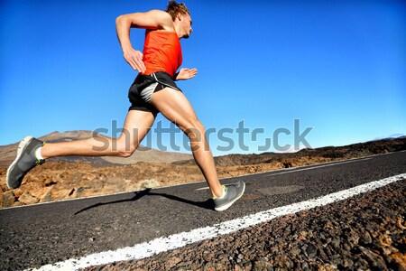 Running sprinting woman - female runner training Stock photo © Maridav