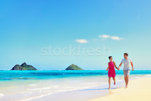 Hawaii vacation couple walking on turquoise beach Stock photo © Maridav