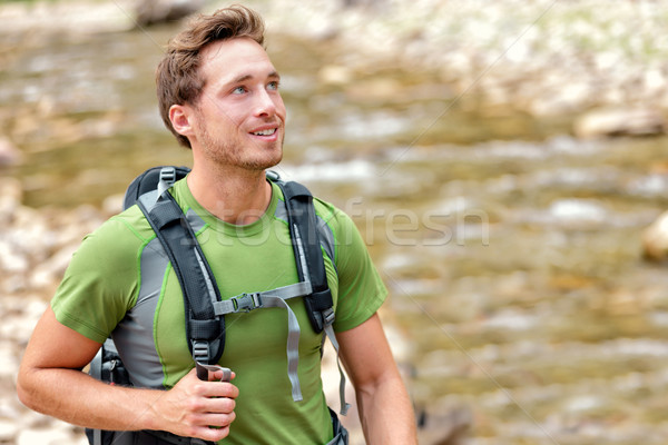 Happy hiker hiking in nature in clean river water Stock photo © Maridav