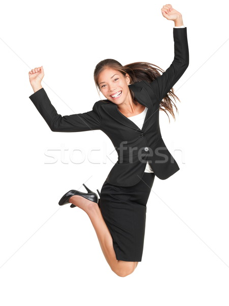Celebrating businesswoman jumping Stock photo © Maridav