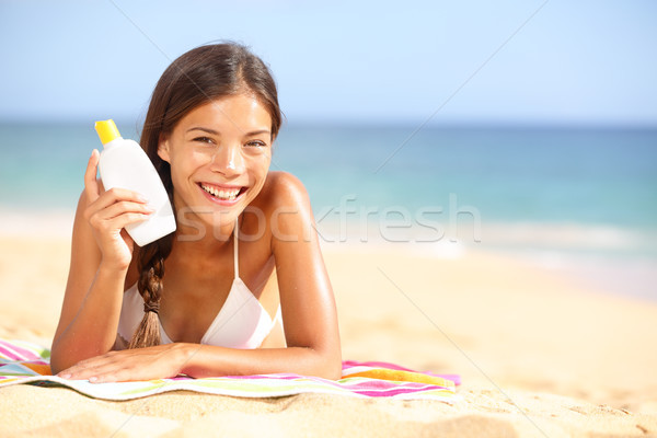 Stock photo: Sunscreen woman showing suntan lotion bottle