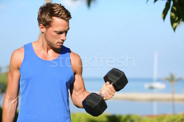 Bicep curl - weight training fitness man outside Stock photo © Maridav
