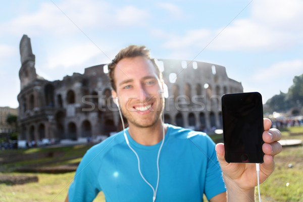Boldog kocogó mutat okostelefon Colosseum fiatal Stock fotó © Maridav