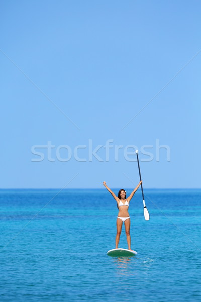 Aspirational beach lifestyle woman on paddleboard Stock photo © Maridav
