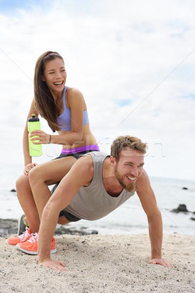 Fitness couple training doing funny push-up Stock photo © Maridav
