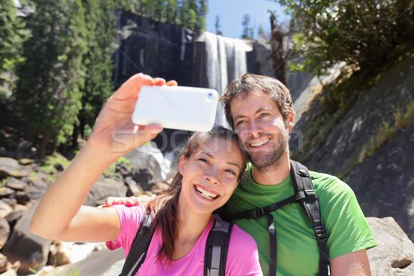 Couple hiking taking smartphone selfie in Yosemite Stock photo © Maridav