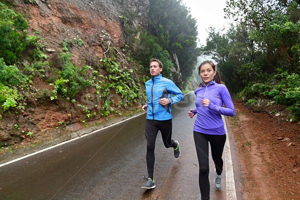 Healthy lifestyle people running on country road Stock photo © Maridav