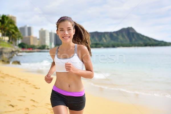 Fut sport fitnessz nő jogging tengerpart fut Stock fotó © Maridav