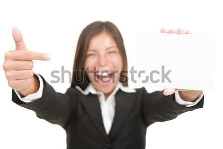 Surprised businesswoman with open hands up Stock photo © Maridav