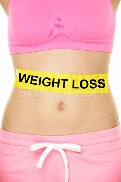 Weight loss concept - Woman waist lower body Stock photo © Maridav