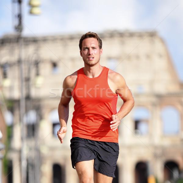 Futó férfi fut Róma maraton Colosseum Stock fotó © Maridav