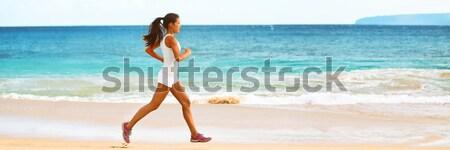Caribbean beach travel - woman legs closeup walking on sand Stock photo © Maridav