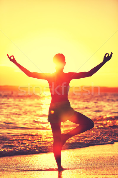 Yoga woman doing morning beach meditation Stock photo © Maridav