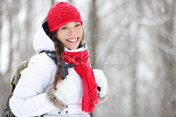 Woman winter hiking in snow Stock photo © Maridav