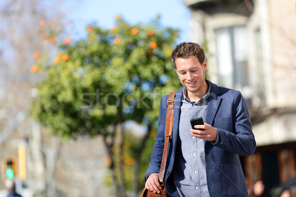 Young urban professional man using smart phone Stock photo © Maridav