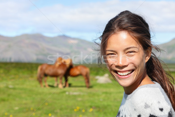 Woman on Iceland smiling with Icelandic horses Stock photo © Maridav