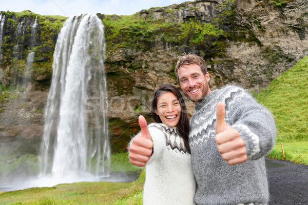 Iceland couple thumbs up wearing Icelandic sweater  Stock photo © Maridav