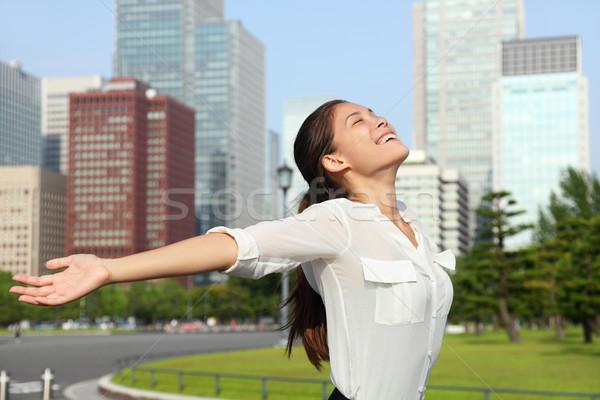 Happy free japanese business woman in Tokyo, Japan Stock photo © Maridav