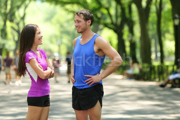 Happy runners couple talking after run in NYC park Stock photo © Maridav