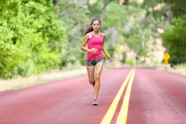 Running fit woman - female runner training Stock photo © Maridav
