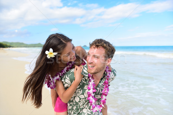 Beach couple having fun laughing on Hawaii holiday Stock photo © Maridav