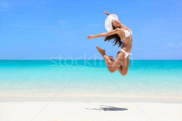 幸せ ビーチ 女性 ジャンプ 成功 ストックフォト © Maridav