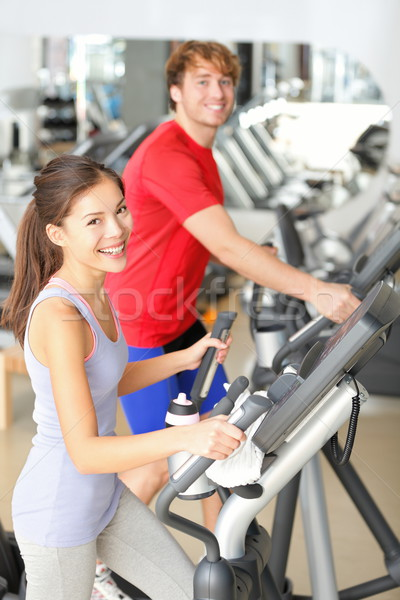 Gym people in fitness center Stock photo © Maridav