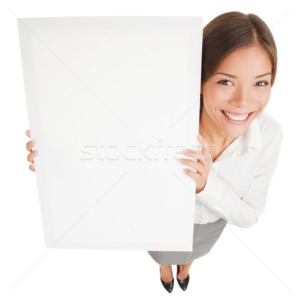 Nő mutat fehér tábla felirat poszter magasról fotózva Stock fotó © Maridav