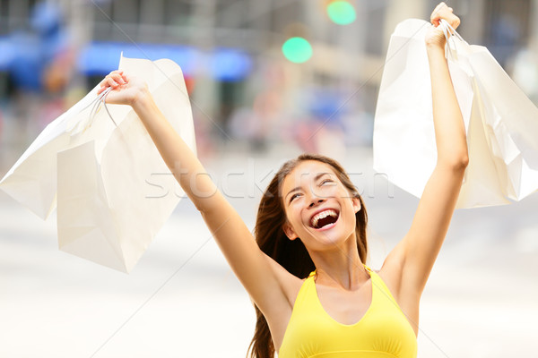 Happy shopping woman in excited winning Stock photo © Maridav