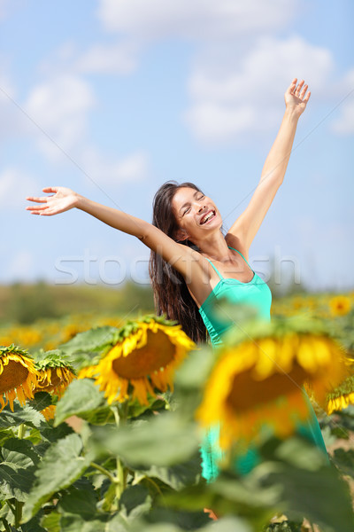 Stock photo: Summer girl happy in sunflower flower field