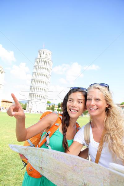 Travel tourists friends holding map in Pisa, Italy Stock photo © Maridav