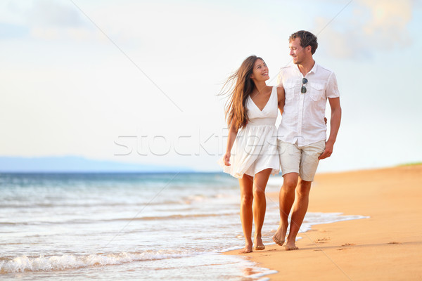 Beach couple walking on romantic travel Stock photo © Maridav