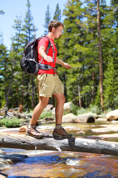 Hiking man hiker crossing river in Yosemite Stock photo © Maridav