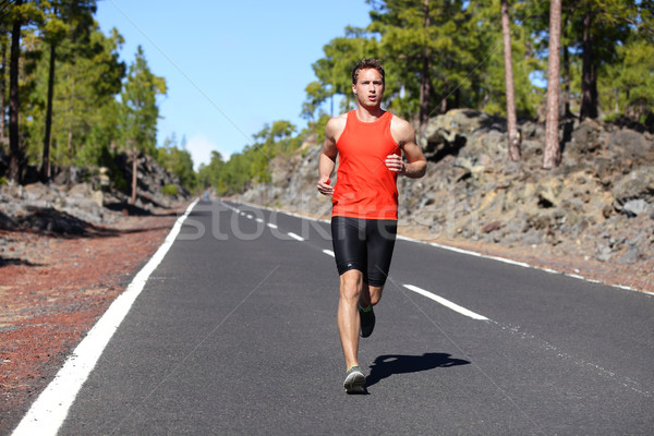 Running man - male runner jogging Stock photo © Maridav