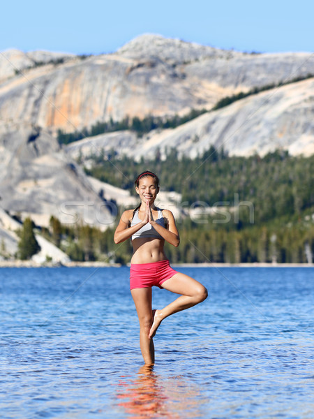 Yoga meditation woman meditating in nature lake Stock photo © Maridav