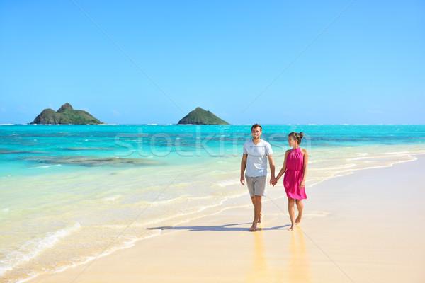 Summer vacation couple walking on Hawaii beach Stock photo © Maridav