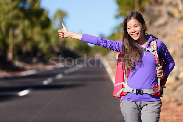 Travel hitchhiker woman backpacking hitchhiking Stock photo © Maridav